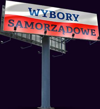 billboard plakat z napisem Wybory Samorządowe na tle flagi Polski